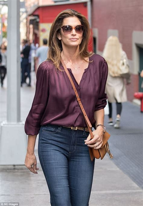 Blouse Casual Chic Biru cuts a casual chic figure in sheer blouse daily mail