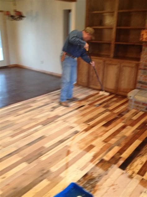 made out of wood pallets a wood floor made out of pallets here is a how to with