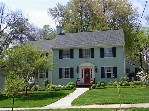 architecture painted brick houses with lawn painted