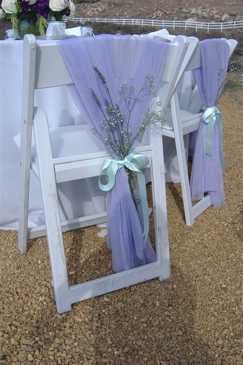 Lavender wedding chair with chiffon and baby's breath and