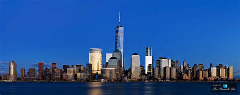 manhattan view freedom stands with one world trade center in lower