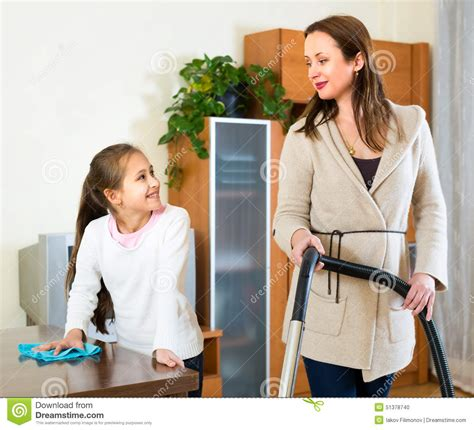house mom mother and daughter cleaning house stock photo image 51378740