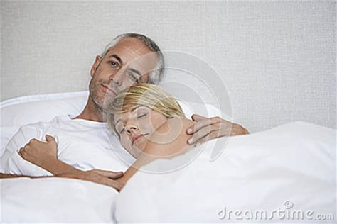 romantic couple in bed images romantic couple relaxing in bed stock image image 33832461