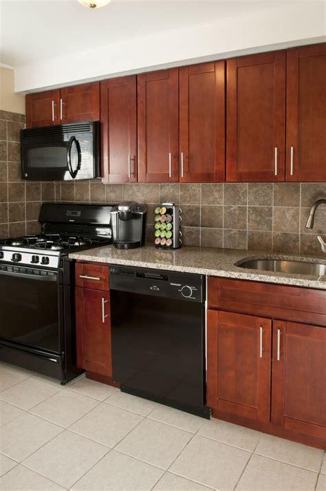 Cer Kitchen Cabinets Cherry Cabinets Granite Countertops Black Appliances Including Dishwashers And Built In