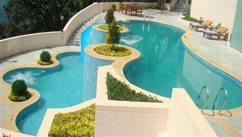 Greenery Code outdoor multi tiered swimming pool at radisson jass shimla