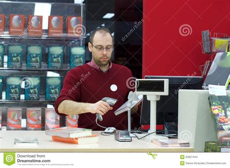 shop assistant scanning a book stock images image 23927444