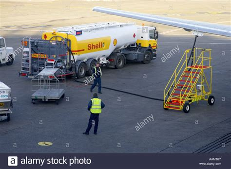shell aircraft fuel tanker driver approaches refuelling rig as ground stock photo royalty free