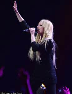 Hand in the air avril rocked out at star studded concert held at the