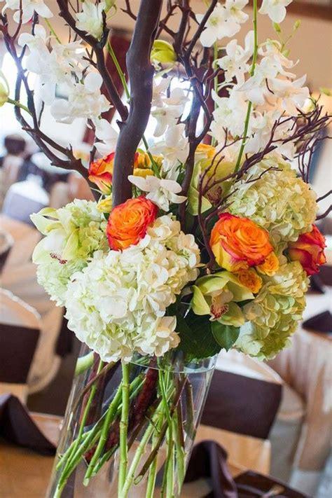 rami e fiori centrotavola per un matrimonio in autunno foto