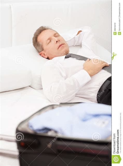 lay on the bed tired businessman sleeping stock photography image