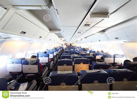 Airplane Cabin by Airplane Cabin With Passengers Royalty Free Stock Images