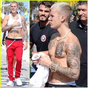 justin bieber latin tattoo justin bieber debuts ferocious new ink pictures inside