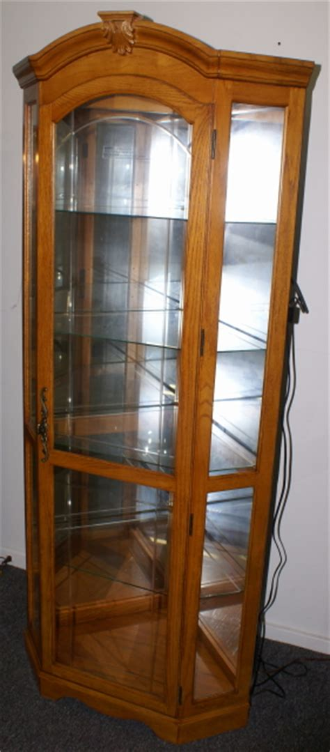 lighted etched glass front oak corner curio cabinet by