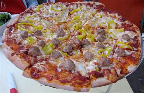 Candle Pizza By The Slice by Wisconsin A Disappointing Dud At The