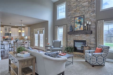 great room   story ceiling gas fireplace  stone