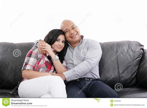 couple on sofa couple sitting on a sofa royalty free stock photography