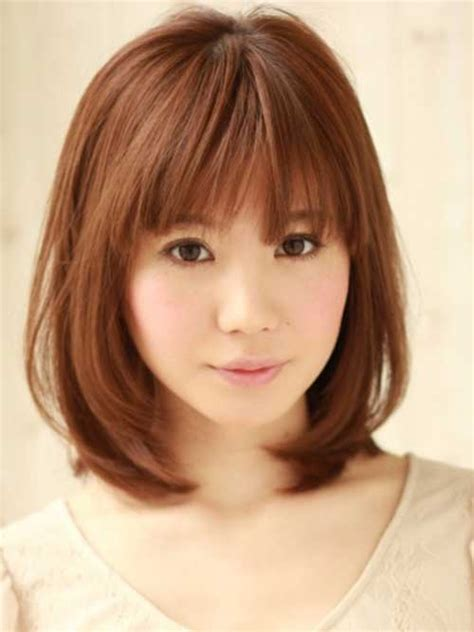 chinese ball with bang hair style 20 medium bobs with bangs the best short hairstyles for