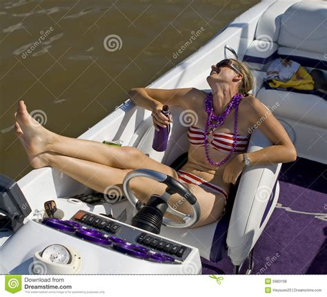 mariah boat swim platform young lady in bathing suit laughing on a boat royalty free