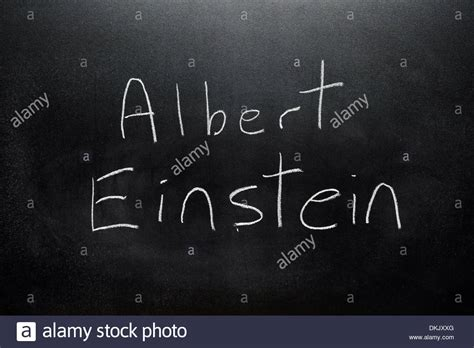 name a a blackboard with the name albert einstein written on it in white stock photo royalty