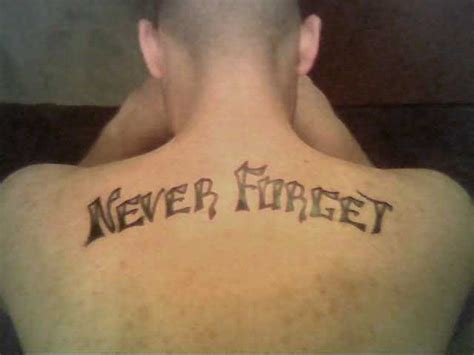never forget tattoo amazing never forget ambigram on upperback