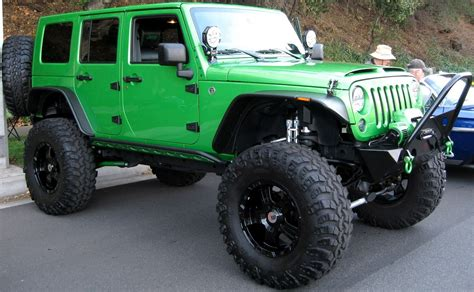 big jeep i loveee jeep wranglers 4 doors with a lift and big tires