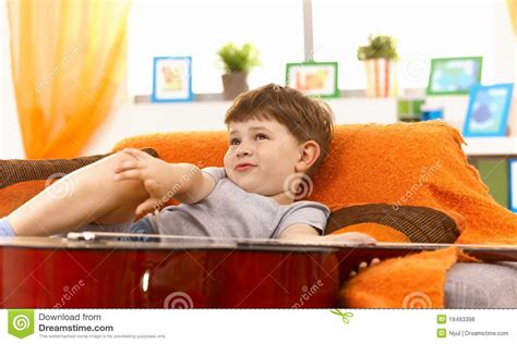boy on couch cute little boy thinking on couch royalty free stock