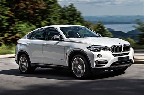 suv bmw 2015 2015 bmw x6 xdrive50i front three quarter view in motion 6