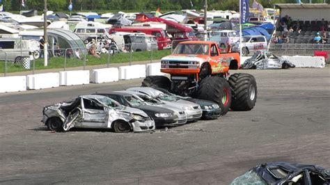 of trucks crushing cars podzilla truck crushing cars