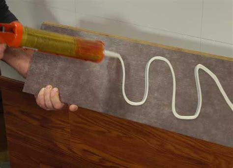 Pvc Boden An Wand Kleben by How To Build A Wall Using Laminate Flooring The Home