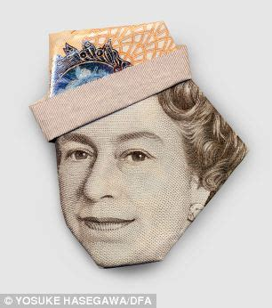 Uk Money Origami - gandhi in a baseball cap and the in a turban it