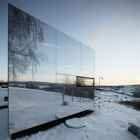 mirrored house delugan meissl s prefab home serves as an invisible retreat