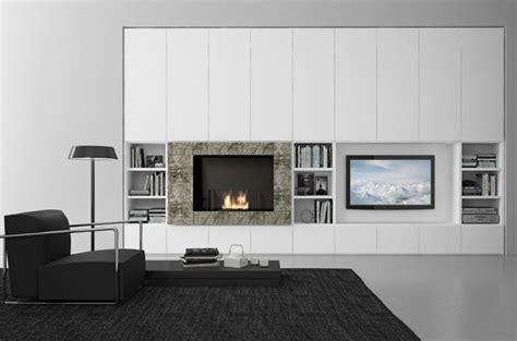 parete attrezzata moderna con camino la parete attrezzata con camino valorizzare il fireplace