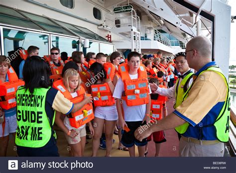 Muster Drill Cruise Passengers Are Led Through A Muster Station Drill Before Ship Stock Photo Royalty Free