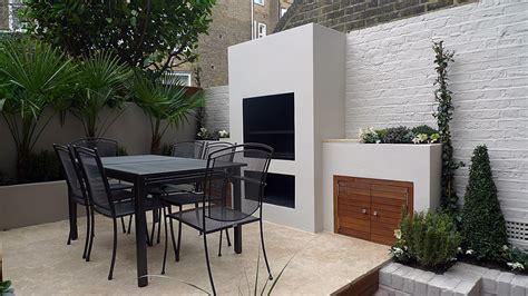 Bespoke outdoor BBQ kitchen fireplace cupboards travertine