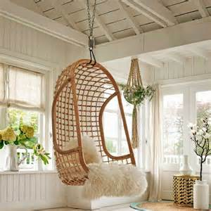 Glamourous rattan hanging chair in brown with white fur seat also iron