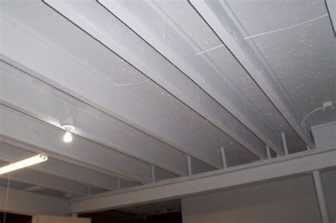 How to Paint a Basement Ceiling with Exposed Joists for an