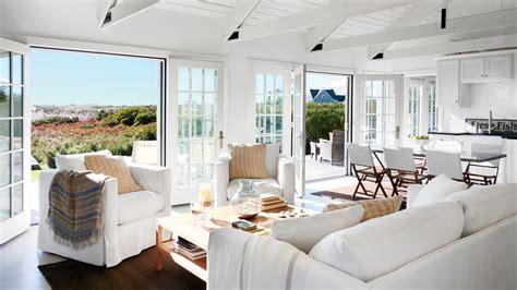 beachy neutral bedroom louvered doors boho beach style 48 beautiful beachy living rooms coastal living