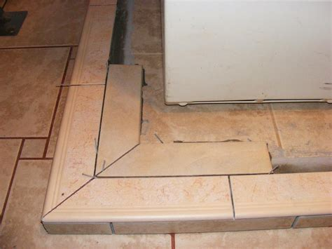 pecos sww installing ceramic bullnose tile on a washer and dryer catch basin perimeter