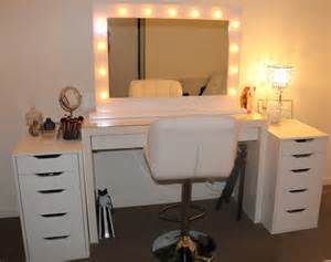 Bathroom white wooden dresser table with lighted mirror