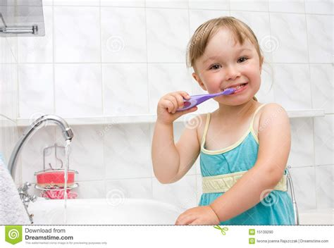 a girl using the bathroom little girl in bathroom stock photo image 15139290