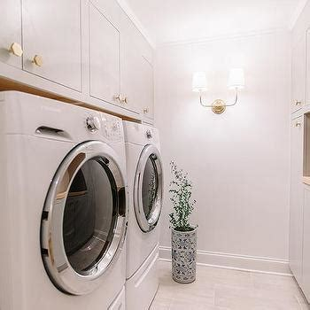 gray cabinets with gold hex knobs transitional laundry
