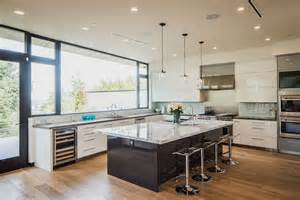 kitchen with white lacquer cabinets dark wood island and light view more kitchens