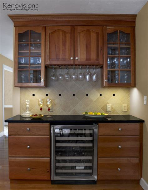 kitchen remodel by renovisions decorative and black tile backsplash granite countertops