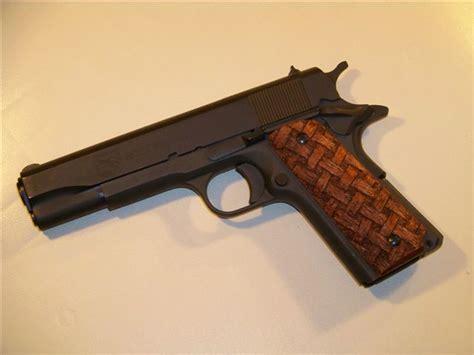 Handmade Gun Grips - a custom carved pair of 1911 pistol grips custom gun