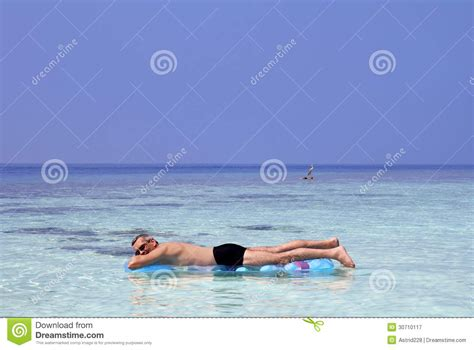 a enjoys and an air bed royalty free stock photography image 30710117