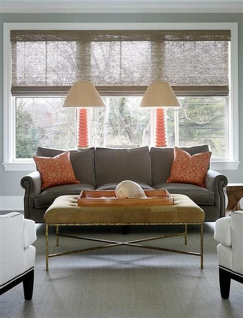 orange and gray living room orange and gray living room features a gray velvet sofa lined with orange pillows lined with a
