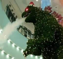 geeknation huge smoke breathing godzilla christmas tree in