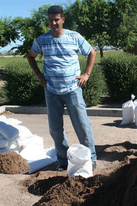 filling sandbags mayor urges to prepare for