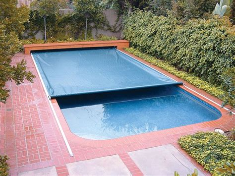 Covered Swimming Pool | on deck track automatic swimming pool safety covers