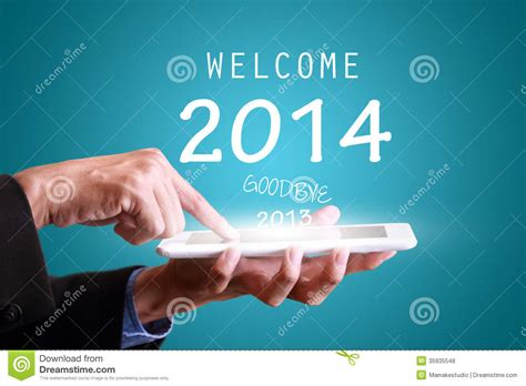 new year touching businessman touching tablet pad for new year 2014 stock